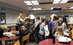 A Sheriff's Deputy shared about his job and  allowed students to try on his gear.