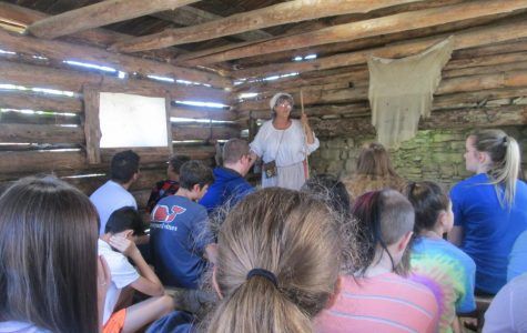 Eighth graders listen in the school house at Fort Harrod.