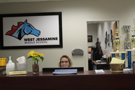 Mrs. Cook is one of the many people who work in the front office.