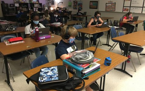 Students working in a classroom during the first week back at school.