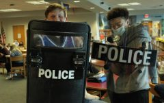 Eighth-grade students try out SWAT equipment.
